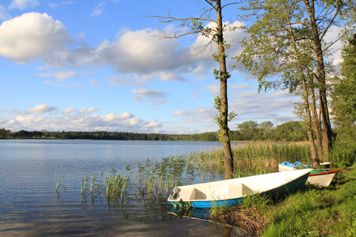 Small Boats on Shore of lake. Mazury. Poland